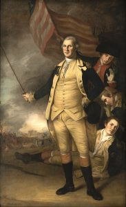 A painting, it shows George Washington in the center, with the American Flag behind him and three men. Hugh Mercer is the man in the top left, with a hat on and a red jacket.